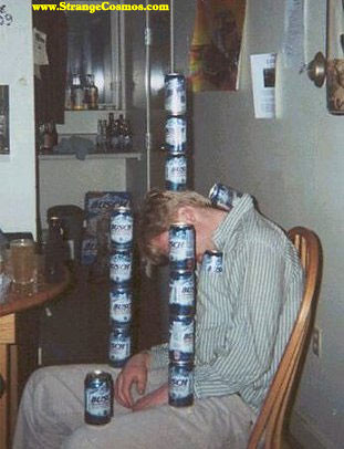 another drunk due to becomes part of an art installation as beer cans are stacked as many as four high all over his body, stuffed in a shirt, and balanced on his head -- clearly this guy is not moving
