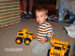 Drewbie with new toys from Grandma and Papa