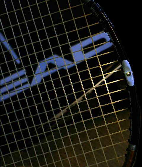 tiny hole through the racket