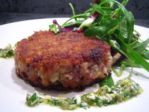 Finished pig's trotter, served with sauce gribiche and dandelion salad
