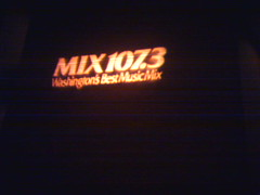 mix 107.3 logo projected onto a brick wall