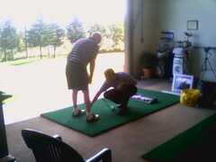 dad gets a golf lesson