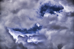 Moon Peeking Through Storm Clouds photo by Gary.Lamprecht
