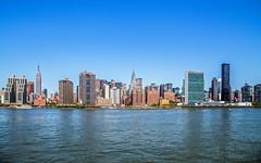 Manhattan Skyline along the East River photo by 12bluros