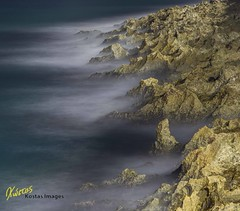Rocks and sea photo by Kostas Trovas
