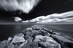 Plum Island Massachusetts, Daytime Long Exposure of Cumulous Clouds clearing to Atlantic Ocean over Jetty photo by Greg DuBois Photography