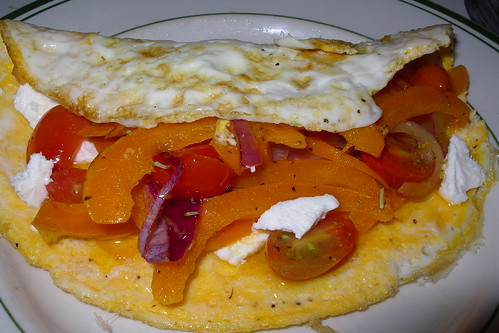 omlette stuffed with goat cheese, grilled onion, orange pepper and cherry tomatoes