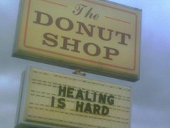 donut shop sign: 'healing is hard'
