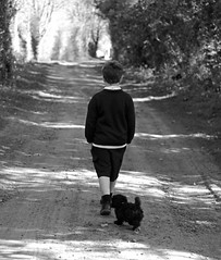 Boy Walking With Dog. photo by meg_nicol
