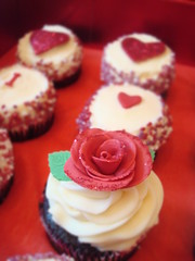 Valentine cupcakes - single red rose & glittery hearts photo by Angelina Cupcake