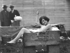 Nude girl lounging in a box full of rabbit fur photo by UW Digital Collections