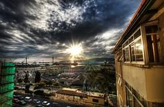 afternoon sun peeps through the clouds photo by Jonathan Ablitt