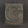 Caslon metal type letter C