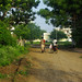 Two Indians walking on a dirt road in Yavatmal, India