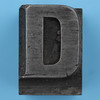 metal type letter D
