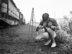 Fred Clark Jr., Florida's well known railroad photographer is working with his bar mounted dual twin lens reflex camera set-up at Sanford, Florida, 1976 photo by alcomike43