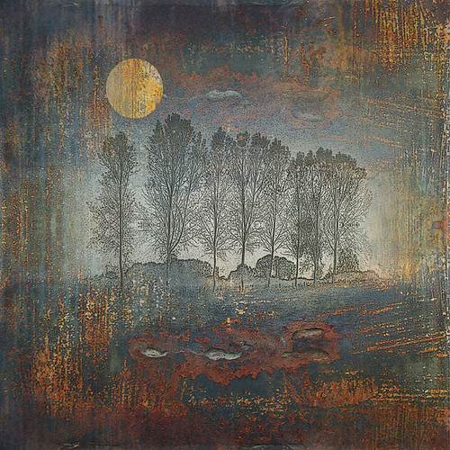 New moon rising over rustic landscape