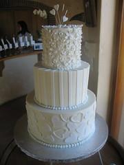 Study of white wedding cake on white chocolate ganache icing photo by Charly's Bakery