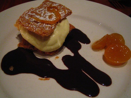 Cardomom Cream filled dessert with Chocolate Sauce and Kumquats
