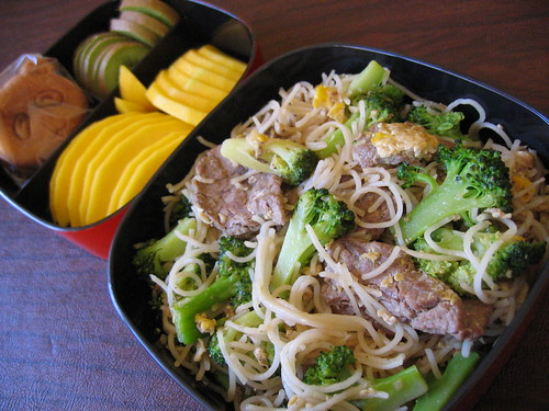 [bento with broccoli, beef & noodles stirfry, fruit tier]