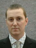 Philip McGuigan MLA
