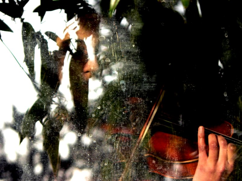 Violinist Through Dirty Glass