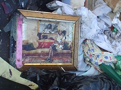 a broken photo frame left behind the refugees.