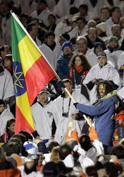 Ethiopia's Robel Teklemariam waves the flag during the opening ceremony for the Turin 2006 Winter Olympic Games Friday, Feb. 10, 2006 in Turin, Italy. (AP Photo/Jasper Juinen)