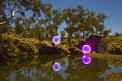 Ball of Light - Watering Hole at Night photo by biskitboy