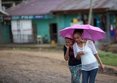 Teenager girls sheltering under an umbrella, Ethiopia photo by Eric Lafforgue