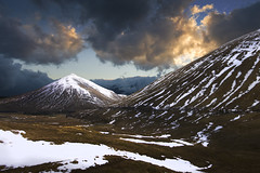 Scotland / mountains / highlands / clouds / landscape / snow photo by ewahrlich