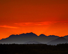 Sunset over the Olympics photo by Derek Lyons