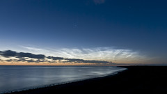 Noctilucent clouds over the ocean photo by thomas bach nielsen