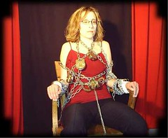 Dayle Krall's Chained Chair escape photo by Dayle Krall:Most Accomplished Female Escape Artist