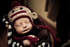 Newborn Baby Boy wearing a Sock Monkey Hat photo by sock monkey kook