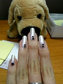 doggy checks out pretty nails