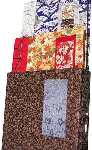 two Asian bindings in a wrap-around case