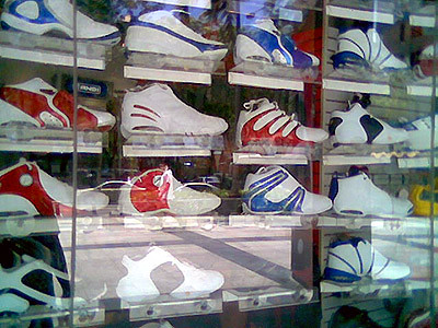 A window display of rubber shoes in one mall.