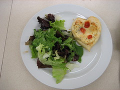 Fresh tossed salad with three cheese tart
