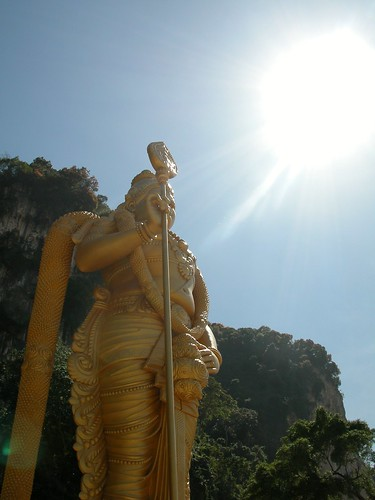 Batu Caves Temple with massive golden statue of the Hindu god Muruga