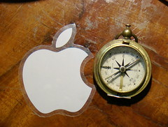 Compass (old) VS  (old) apple. photo by massimiliano