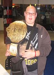 Damian wearing Batista's World Wrestling Heavyweight Championship Belt