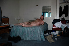 man nude reclining on bed
