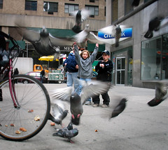 Kids scaring pigeons on Broadway photo by NYCArthur