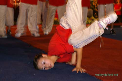 (this pretty lass is the only girl in the all-boys breakdance group)