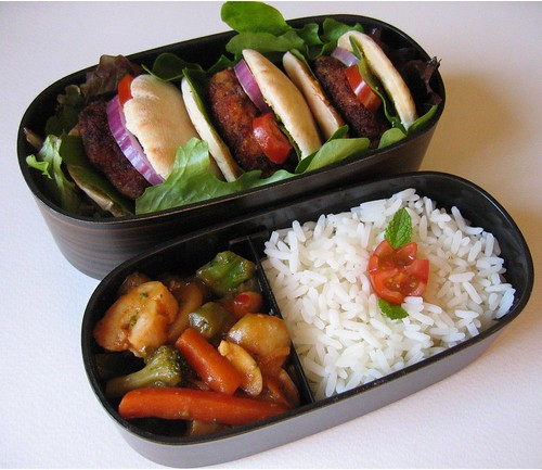 [bento with mini shrimp burgers, rice, kung pao chicken]