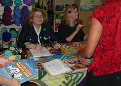 Ann and Kay sign books