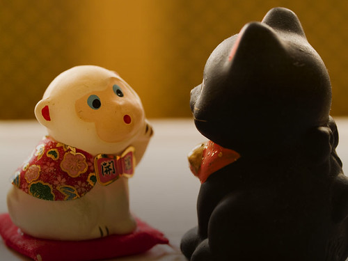 Ms. Monkey tells a secret to Mr. Cat