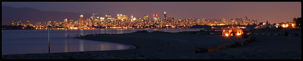 Vancouver skyline at night with beach fire