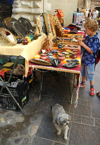 Craft stall with dog, Uzes, France, June 2006